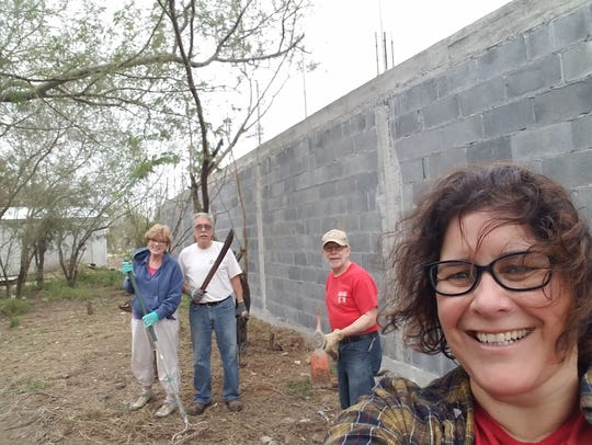 Sabina Persons takes a selfie while she and other members