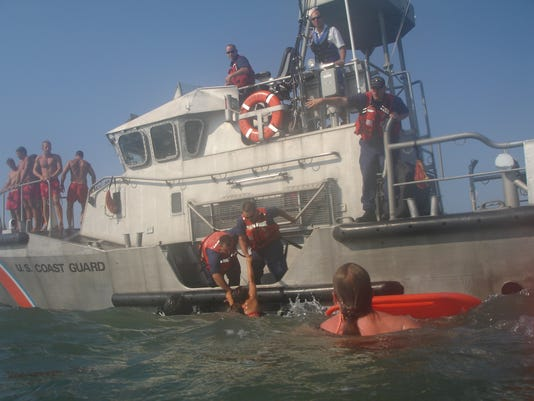 Coast Guard, beach patrol rescue person from rip current