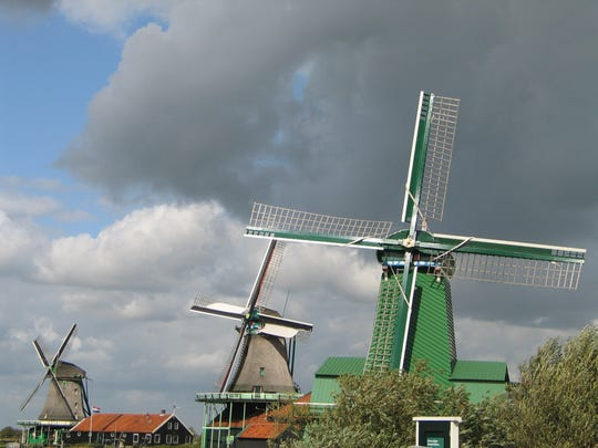 Some of the last working windmills in the region are at the historic village of Zaanse Schans, about 15 minutes by train northwest of  Amsterdam.  2009 FILE PHOTO