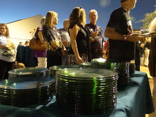 Glass plates and stemware provided at the gala must