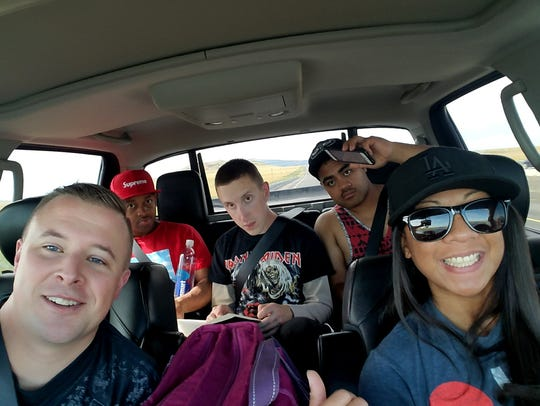 Capt. David Geaney and Staff Sgt. Heidi Agustin-Dominguez, in the front, and Paul Brooks, Greg Callaham and Billy Suai, from left to right in the backseat, make their way to Houston where they helped run a Red Cross supply shelter following Hurricane Harvey. All five are members of Red Horse.