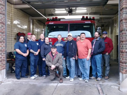Current and retired firefighters gather for the send-off for Fire Engine 6 on Dec. 18, 2017.