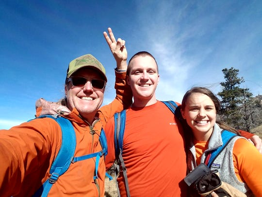 Rich Dozier, his son Camp and Camp's wife, Allyson take a break during their hike on Miner's Road Trail.