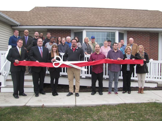 A ribbon-cutting ceremony was conducted in Alexandria on March 29 for a group home for people with developmental disabilities. The home is operated by Alternatives Inc., a service provider for people with disabilities living in Central Jersey. From left: Alternatives Trustee Morris Malmstrom; Hunterdon County Chamber of Commerce President Chris Phelan; Alternatives President Nancy Good; Alexandria Township Deputy Mayor Christian Pfefferle; Alternatives clients and residents Nathan Druskin and Joseph Murphy; and Alternatives Trustees Helen Grunwald and Alexandra Zeng.