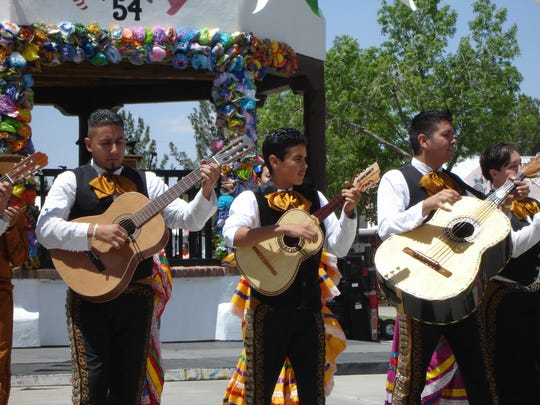 Maraichi guitarists beat out the unique rhythms of Mexican folk music during Cinco de Mayo festivities on the Mesilla Plaza.