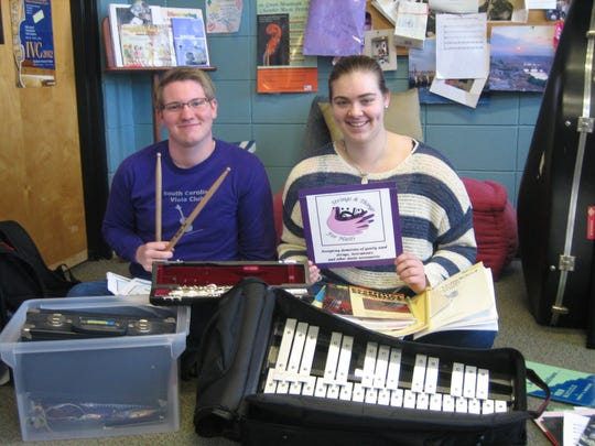 Students at the Governor's School for Arts and Humanities collect instruments for Haiti.