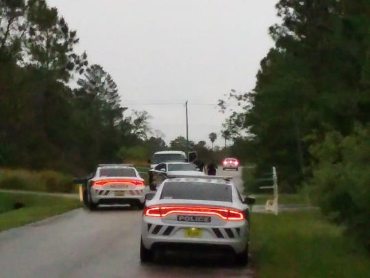Police converge on Ricardo Street, SE, in Palm Bay