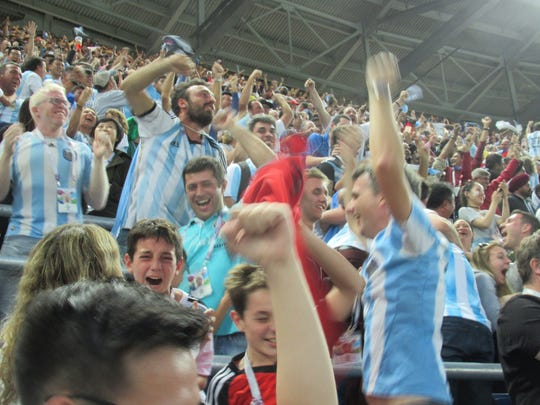 Apoplectic Argentina fans cheer after their side's first goal.