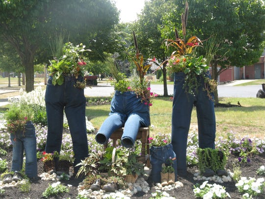 One of the floral displays created by Clyde in Bloom utilizes old blue jeans.