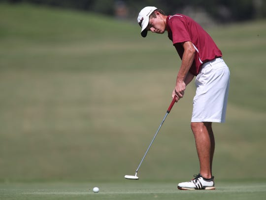Charlie Wilkey of Chiles plays during the Boys golf