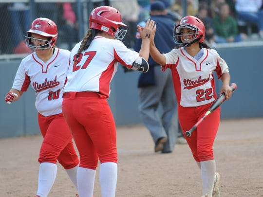 Vineland's Gabrielle Pratts high fives Devin Coia after