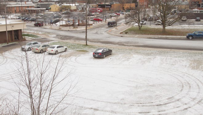 A hilltop view of the lot earmarked for construction of a multi-story parking structure is seen from the parking lot of the Greater Brighton Area Chamber of Commerce office.