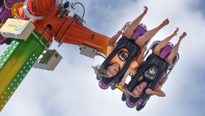 Courtney Linn, left, and Grace Middendorf enjoy one of the Midway rides at the Stearns County Fair Wednesday, July 26, 2017, in Sauk Centre.