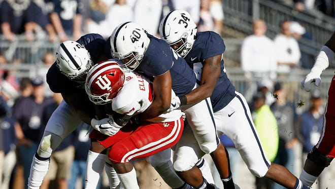 Penn State defenders Marcus Allen (2) Jason Cabinda (40) and Shane Simmons (34) tackle Indiana's Morgan Ellison (27) during the first half of an NCAA college football game in State College, Pa., Saturday, Sept. 30, 2017.