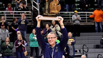 Clarkson head coach Dan Fife finally got to a hoist a state-title trophy, after 35 years on the job.
