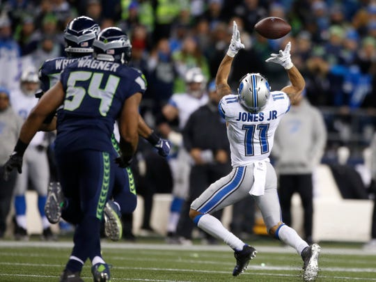 Lions receiver Marvin Jones bobbles a pass against the Seahawks in the NFC wild-card game at CenturyLink Field on Jan. 7, 2017 in Seattle.