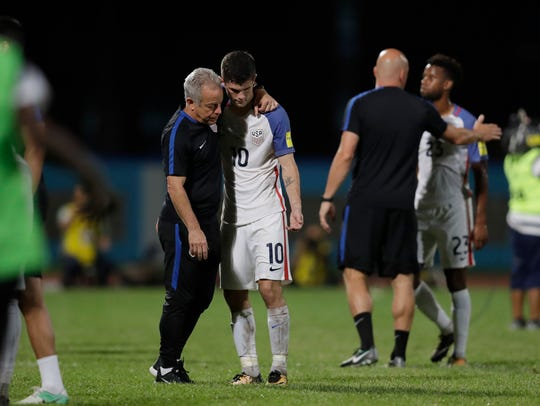 United States' Christian Pulisic, (10) is comforted