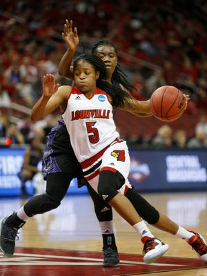 Louisville's Taja Cole drives past Central Arkansas' Sandy Jackson. March 18, 2016.