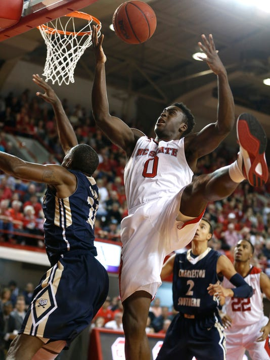 N.C. State's Abdul-Malik Abu (0) fights for a rebound with Charleston Southern's Cedrick Bowen (24) during the first half of the Wolfpack's game against Charleston Southern at Reynolds Coliseum in Raleigh, N.C., Friday, Dec. 12, 2014. (AP Photo/The News & Observer, Ethan Hyman)
