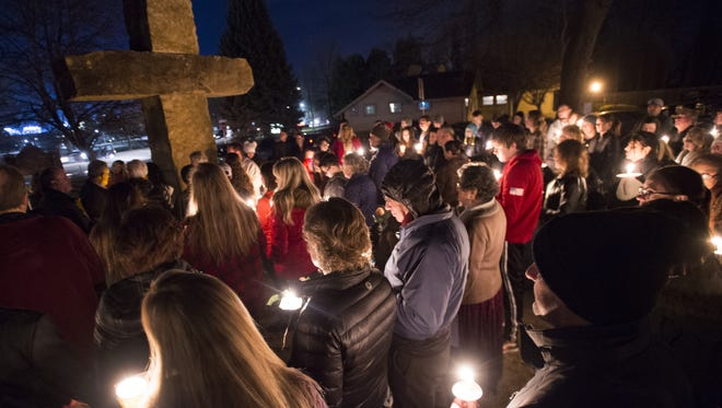 Family and friends of Kimberlee Graves are illuminated by candles as they for a candlelight vigil near University Avenue on Friday, January 19, 2018. Graves' body was found January 9 in Lory State Park.