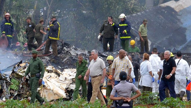 Cuban President Miguel Diaz-Canel, center, is pictured at the site of the accident after a Cubana de Aviacion aircraft crashed after taking off from Havana's Jose Marti airport on May 18, 2018. A Cuban state airways passenger plane with 113 people on board crashed on shortly after taking off from Havana's airport, state media reported.