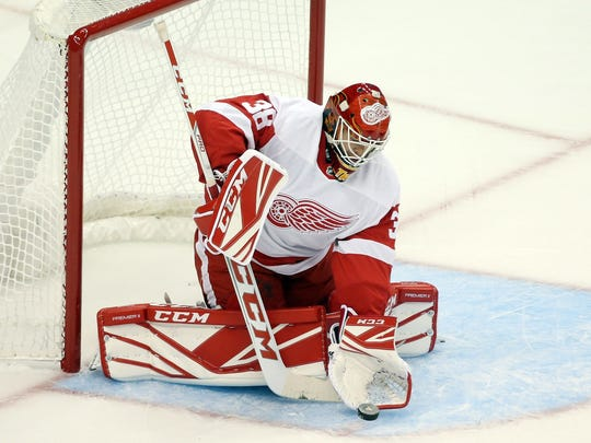 Detroit Red Wings goalie Tom McCollum (38) makes a save against the Pittsburgh Penguins on Sept. 20, 2017, during the second period at the preseason game at PPG PAINTS Arena in Pittsburgh.