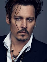 Johnny Depp poses for Dior.