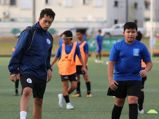 Derrick Cruz, a Boys U12 Division Coach of the United Airlines GFA Center of Excellence, conducts a training session at the Guam Football Association National Training Center in this file photo.