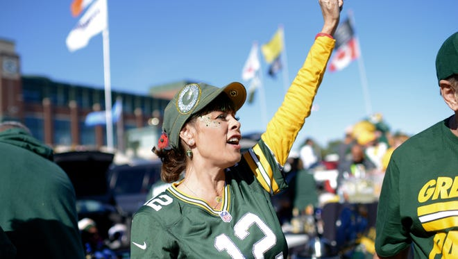 Jules Angel of Rancho Cucamonga, calls out to other fans from California while tailgating before her first Packers game at Lambeau Field in Green Bay, Wis. on Sunday, Oct. 18, 2015. Angel has lived with Amyotrophic Lateral Sclerosis, also known as ALS or Lou Gehrig's Disease for seven years this month.