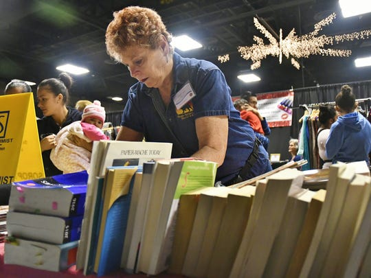 Lyn Awbrey of  Visalia Sunset Lions sold gently used items to raise money for the club's charities during the first annual community yard sale at the Visalia Convention Center on Saturday, Jan. 6.
