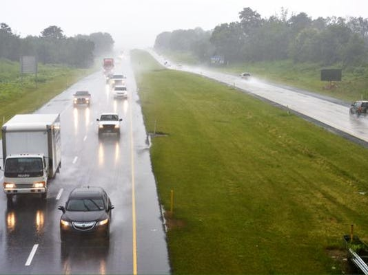 Rain falls as traffic moves along Route 30 looking east from the overpass on Shoe House Road.