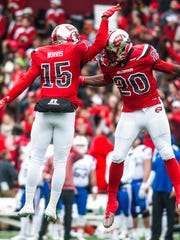 FILE - In this Dec. 3, 2016, file photo, Western Kentucky Hilltoppers wide receiver Nicholas Norris (15) and Anthony Wales (20) celebrate a touchdown during Western Kentucky's 58-44 win over Louisiana Tech, at Houchens-Smith Stadium in Bowling Green, Ky.