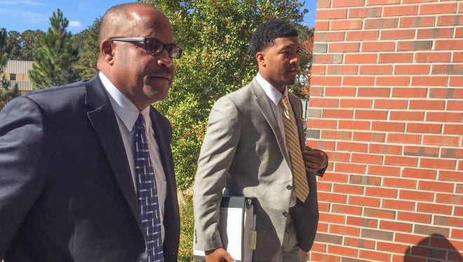 Jameis Winston, right, and his advisor, David Cornwell, arrive for an investigative hearing last month on the campus of Florida State.