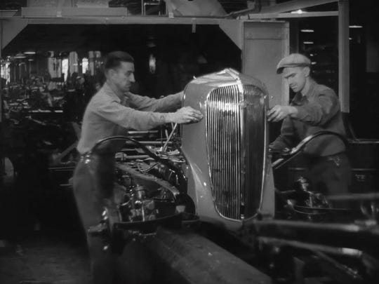 """Master Hands"" illustrates the creation of a car at an auto plant in Flint."