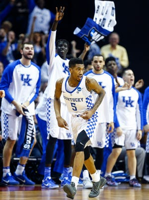 University of Kentucky bench celebrates a made three pointer by Malik Monk (front) during action against UCLA in their NCAA tournament Sweet Sixteen matchup at the FedExForum.