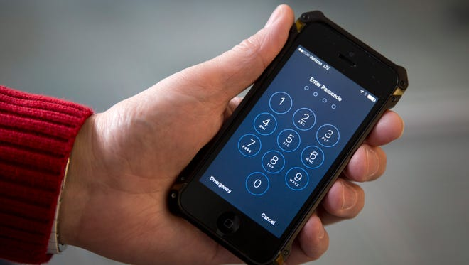 "An Apple iPhone ""enter passcode"" screen."