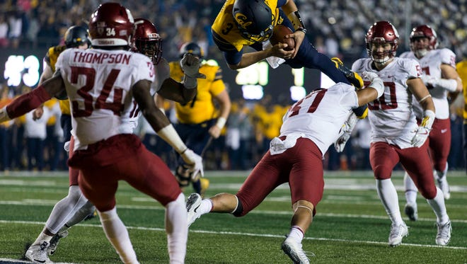 Oct 13, 2017; Berkeley, CA, USA; California quarterback Ross Bowers (3) leaps for a touchdown against Washington State linebacker Justus Rogers (37) during the second half at Memorial Stadium. WSU won 37-3.