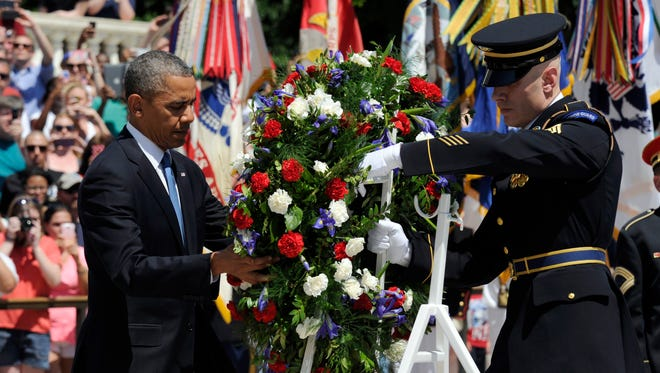 President  Obama lays a wreath at the Tomb of the Unknown Soldier at Arlington National Cemetery on May 26.