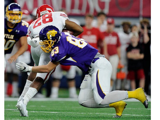 Wylie defensive lineman Ryan Hamar (83) tackles Carthage