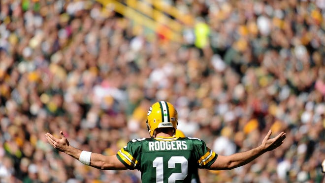 Green Bay Packers quarterback Aaron Rodgers (12) reacts to a play in the second quarter against the St. Louis Rams.
