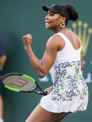 Venus Williams of the United States of America celebrates a break point against Carla Suarez Navarro of Spain on Stadium One during their quarterfinal match at the 2018 BNP Paribas Open at Indian Wells Tennis Garden on March 15, 2018. Williams won the match 6-3, 6-2.