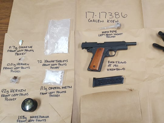 A stolen firearm and other items recovered by Port Hueneme police during an arrest at a Denny's restaurant over the weekend.