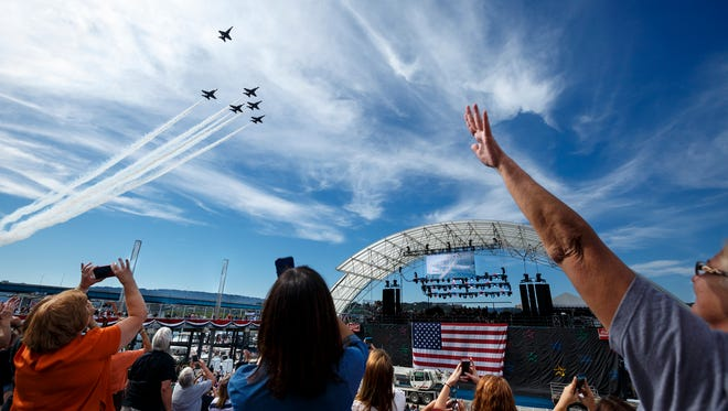 A single jet pulls away from formation to form a missing man formation during a Blue Angels flyby of the Chattanooga Unite Tribute Concert at Ross's Landing on Wednesday, Sept. 16, 2015, in Chattanooga.