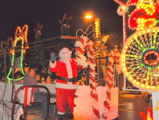 Santa Claus also rode a colorful float.