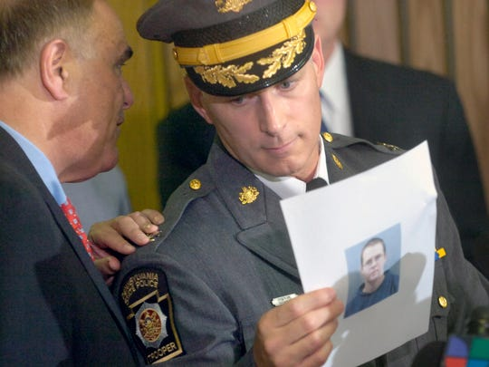 Gov. Ed Rendell, left, talks with state police commissioner Jeffrey Miller as Miller holds a photo of shooter Charles Carl Roberts IV at a news conference Oct. 3, 2006, after the Nickel Mines Amish schoolhouse shooting.    Governor Edward G. Rendell, left, talks with Pennsylvania State Police Commissioner Jeffrey Miller, while miller holds a picture of Charles Carl Roberts IV at a press conference Tuesday. YORK DAILY RECORD/SUNDAY NEWS- PAUL KUEHNEL