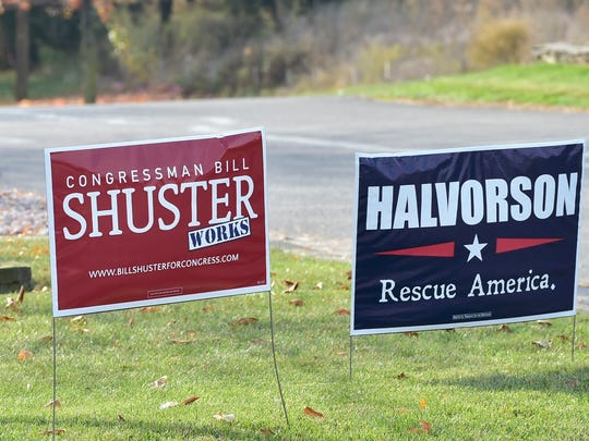 Signs in supports of Congressman Bill Shuster and his opponent, Art Halvorson, appear on a lawn at St. Paul Church, Chambersburg, on Tuesday, November 8, 2016.