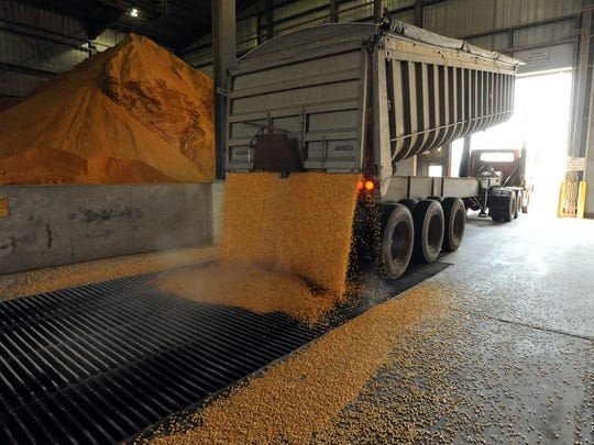 A truck unloads corn at the POET ethanol plant. An expansion would double the plant's capacity.