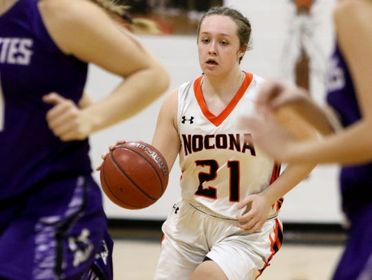 Nocona's Averee Kleinhans dribbles in the game against
