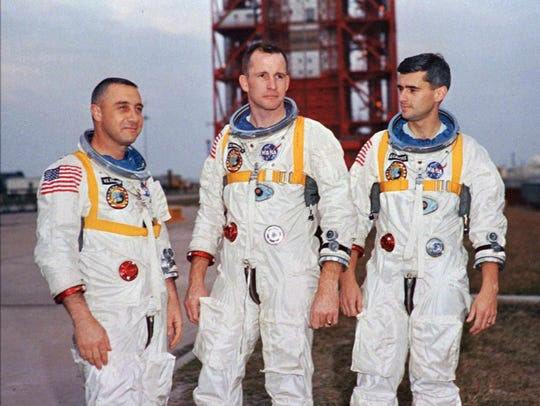 "Apollo 1 astronauts, from left, Virgil ""Gus"" Grissom, Edward White II, and Roger Chaffee pose next to their Saturn 1 launch vehicle in this Jan. 17, 1967, photo at Launch Complex 34 at Cape Canaveral Air Station in Cape Canaveral, Fla."