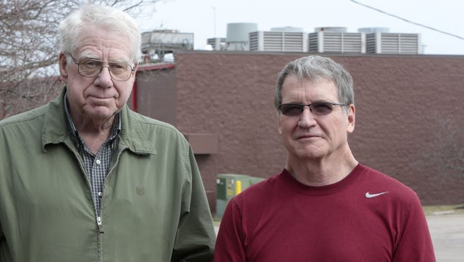 Neighbors George Ball, left, and Jerry Puterbaugh have not been able to use the backyards of their Maineville homes due to excessive noise coming from the air conditioners of a nearby Kroger.
